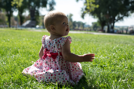 Little girl eyes and breathes the fresh air in the park.