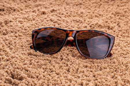 vintage sunglasses on texture.