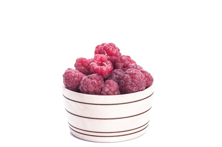 fresh berries in wood bowl isolated.