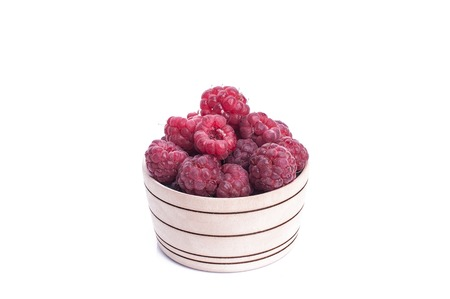 fresh berries in wood bowl isolated