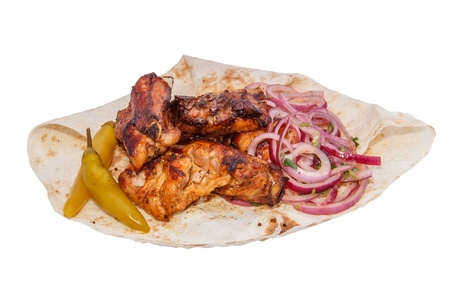 Shish kebab from pork ribs isolated on white background photo