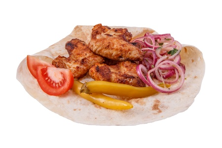 Shish kebab from chicken wings isolated on white background photo
