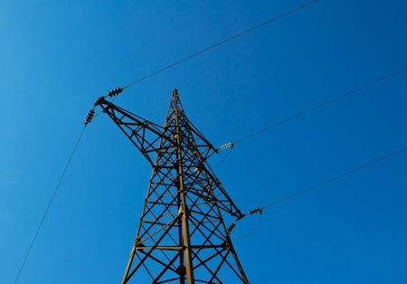 Pylon power lines against blue sky  photo