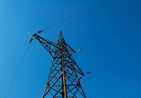 Pylon power lines against blue sky  photo
