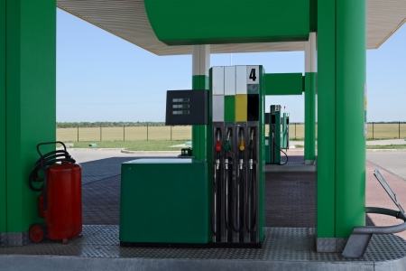 A gas station pumps with car Stock Photo - 17015170
