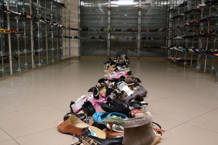 Pile of various female and male shoes in a store photo