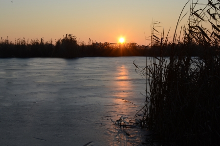 Frozen lake at sunset  sunrise  photo