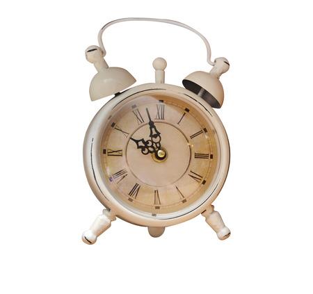 old alarm clock on white