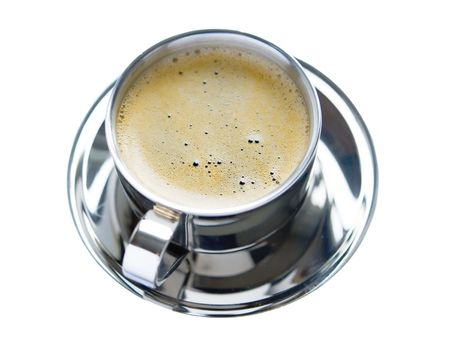 decaf: A cup of coffee with froth isolated over white