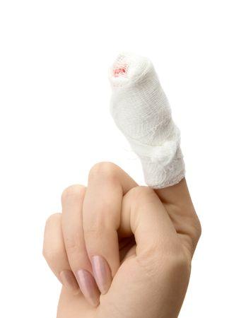 bandaged: Bandaged finger close up on white background