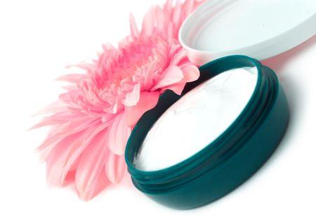 Moisturizing cream with pink gerbera close up photo