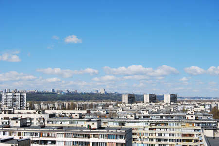 towerblock: thousand of roofs against cloud sky background Stock Photo