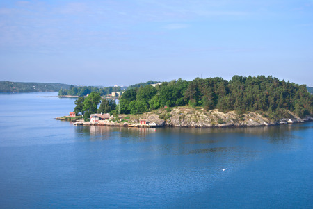 Comfortable cottage on a small rocky island in the Stockholm archipelago, Baltic Sea, Sweden photo