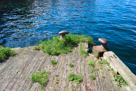 old pier: Norway, old pier in Bergen, metal fixing on the quayside