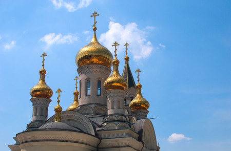 donetsk: Golden domes of Orthodox Cathedral in Donetsk, blue sky in the background Stock Photo