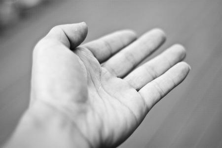 Outstretched hand Фото со стока