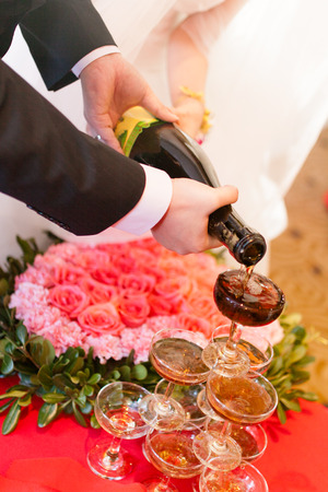 Asian Chinese wedding dinner reception, bride and groom champagne toasting, natural candid photo photo