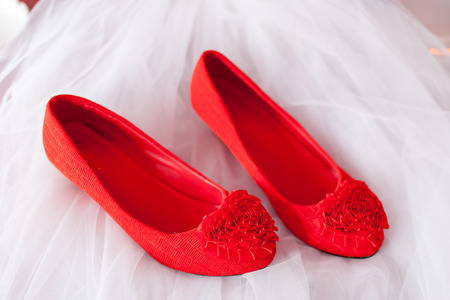 bride \  's red shoe on wedding dress photo
