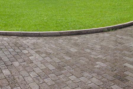 Flagstone floors and grassland Stock Photo