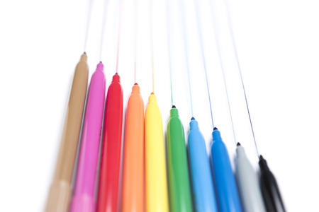 Colorful handwriting markers on white background