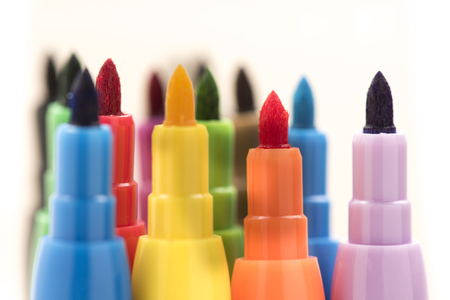 Colorful markers on white background