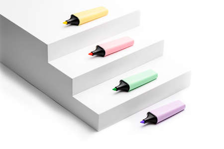4 Pastel highlighters on white background side view Фото со стока