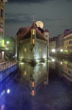 Night view of moon and ancient jail in Annecy, France