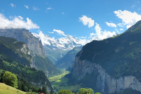 Lauterbrunnen valley in the Swiss Bernese Oberland with the snowcapped peaks of the Alps in the background.