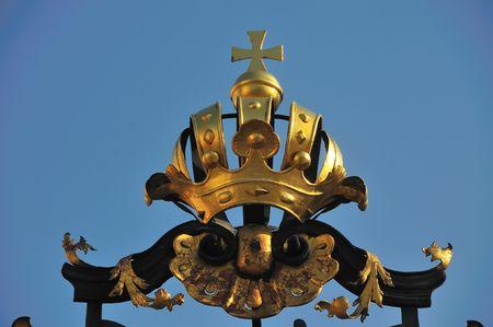 Golden crown decoration on top of gate to Prague Castle.