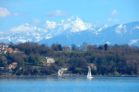 Sailboats on Lake Geneva in Switzerland with  Mount Blanc and the French Alps in the background.
