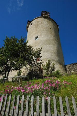 Summer view of the wall and tower of the Castle at Gruyeres Switzerland. Stock Photo