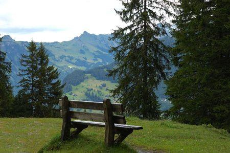 Mountain Bench overlooking Lauterbrunnen valley. Stock Photo