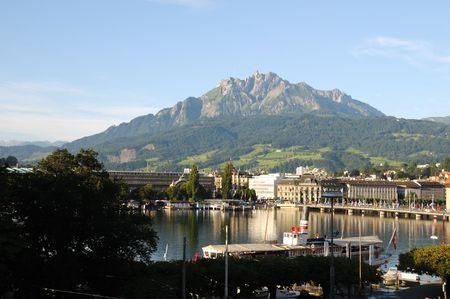 Mount Pilatus towering over Lucerne, Switzerland on a beautiful summers day. photo