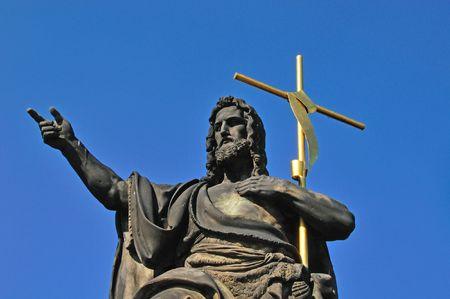 Statue of Christ on Karls bridge in Prague, Czech Republic.