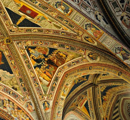 Renaissance art displayed on the ceiling of an old Italian gothic church in Siena.