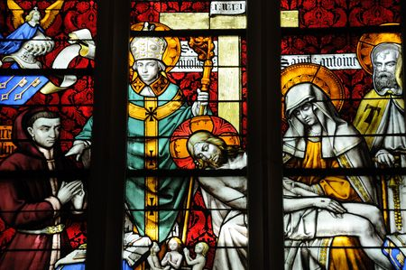 Detail from stained glass window in cathedral in Beaune, France Banco de Imagens