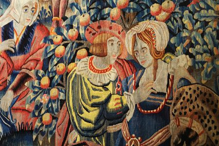 Ancient Tapestry depicting boy and girl flirting.