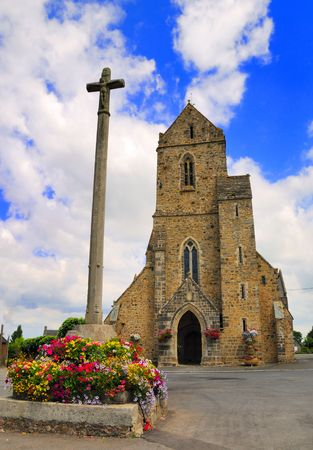 Village church and churchyard in Normandy, France. Stock Photo
