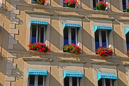 European Hotel with flowered window boxes under windows with awnings.
