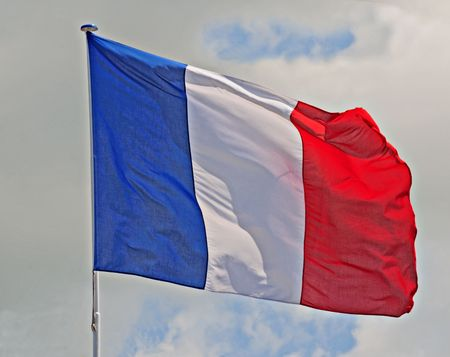French Flag fluttering in a brisk breeze. Stock Photo