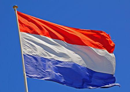 Netherlands Flag fluttering in a brisk breeze. Stock Photo