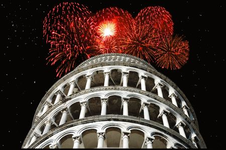Holiday fireworks exploding over the Leaning Tower of Pisa, Italy