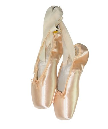 Pair of ladies pink ballet shoes isolated on white background.