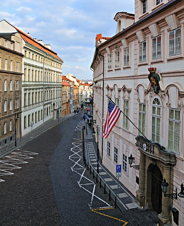 Prague Street with American Embassy and Flag. Stock Photo