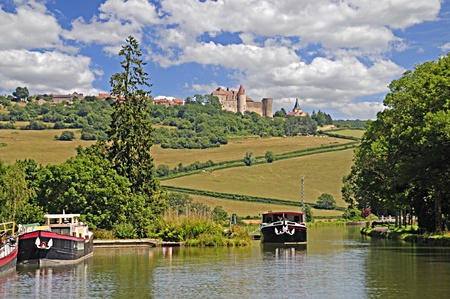 canal street: The road to Chateauneuf in Burgundy on a beautiful summer day.