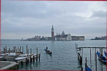 View of a gondola and the Islande of San Giorgio Maggiore in Venice Stock Photo