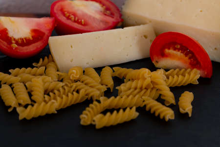 Pasta type penne with the first well defined and blurred background