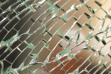 A detail of a shattered window  Stock Photo