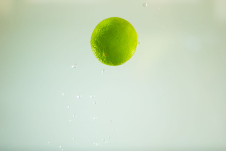 Lemon plunging into water