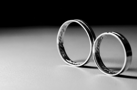 Pair of wedding rings on the table Stock Photo